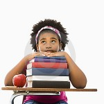 girl-with-stack-of-books--thumb3422993